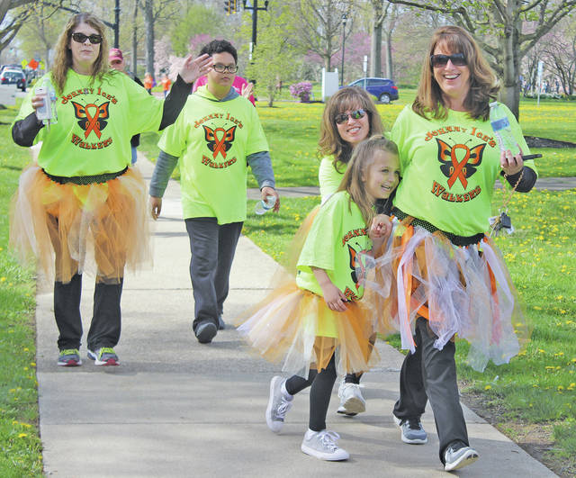 """""""Johnny Ice's Walkers"""" dance across the finish line in tutus. The team raised a little over $4,000."""