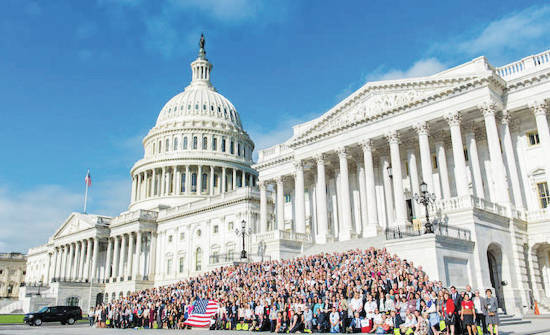 Roughly 1,200 Citizen's Climate Lobby volunteers gather on the steps of the U.S. Capitol.
