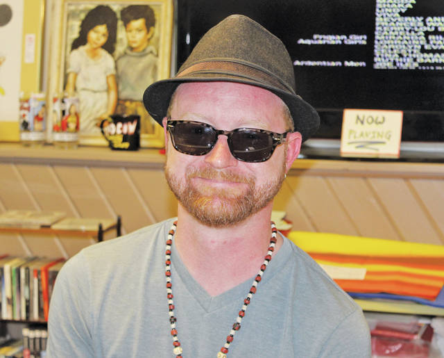 Brent Coward is the owner of a new store on West College Street that sells vintage pop culture collectibles and clothing.