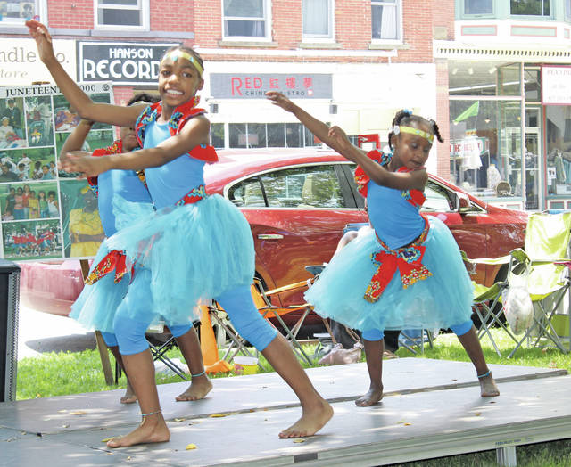 Members of the African Royalty dance team perform traditional African dances to three songs.