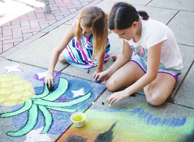 Kids work on their sidewalk masterpieces during the 2017 Oberlin Chalk Walk. This year's event will be held from 10 a.m. to 4 p.m. Saturday.