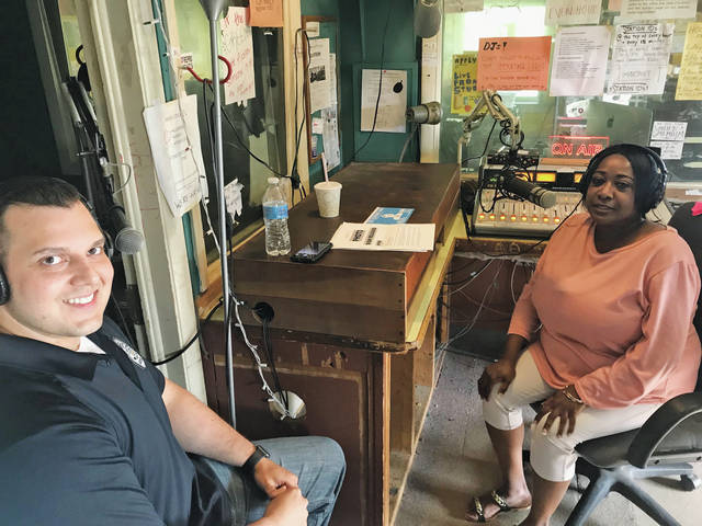 Oberlin police officer Bashshar Wiley is interviewed by Annessa Wyman, president of the Oberlin African-American Genealogy and History Group, during a radio broadcast about a 55-year-old cold case.