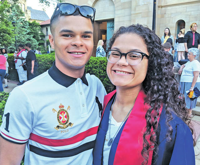 Graduate Kiah Fields poses with her brother, Kobe Fields, a Marine who made a surprise visit home from Japan just in time for commencement.