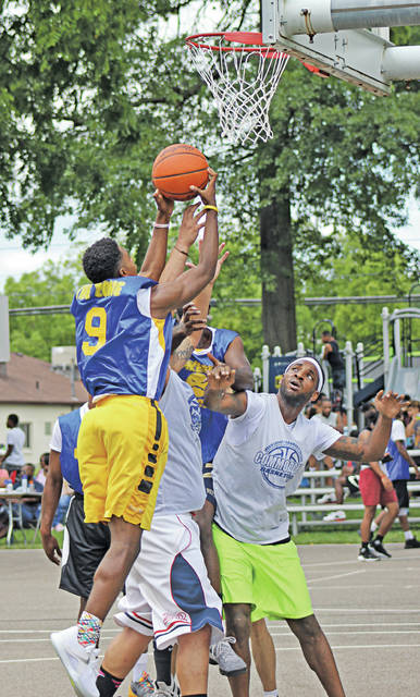 Sam Daniels attacks the hoop in the 2017 Oberlin Outdoor Basketball Festival at Park Street Park.