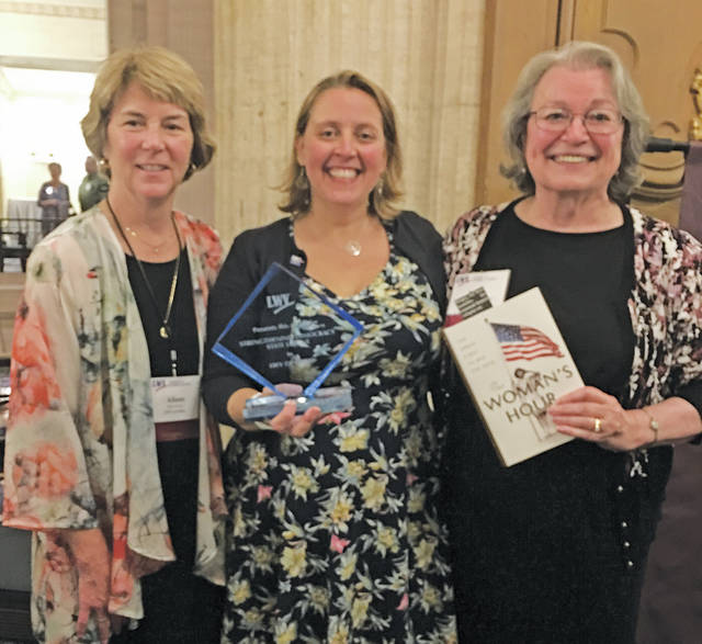 Leaders of the League of Women Voters of Ohio include co-president Alison Ricker, executive director Jennifer Miller, and co-president Mary Kirtz Van Nortwick. Here, Miller holds the Strengthening Democracy Award.