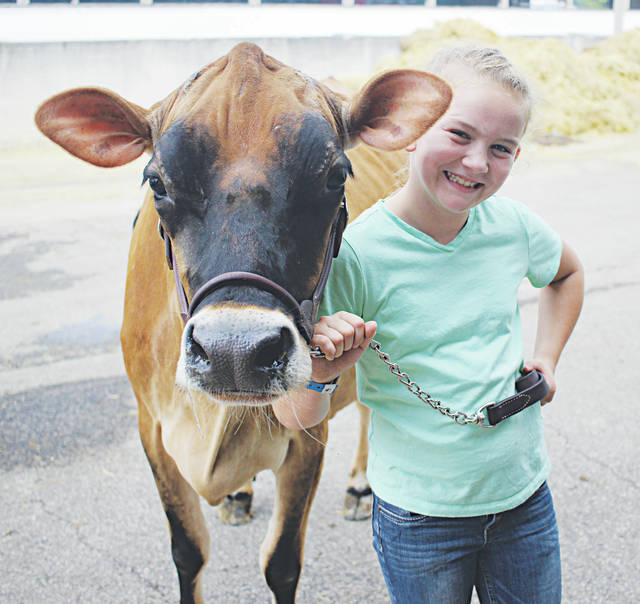 Skylar Squire and her cow say cheese before heading back into the barn at the 2017 Lorain County Fair.