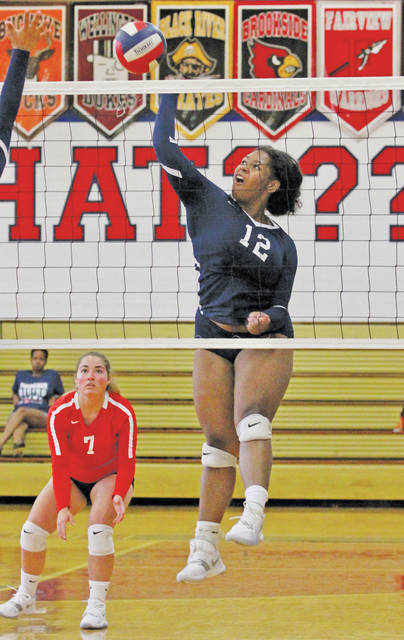 Oberlin junior Bailey Wallace taps one over the net in Saturday's volleyball season opener.