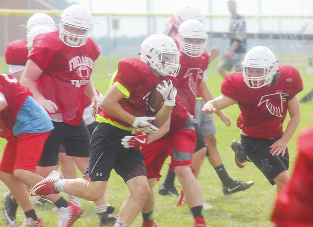 Firelands sophomore running back Donald Crawford weaves through traffic. The Falcons will try to improve on last season's 8-2 record starting Aug. 24.