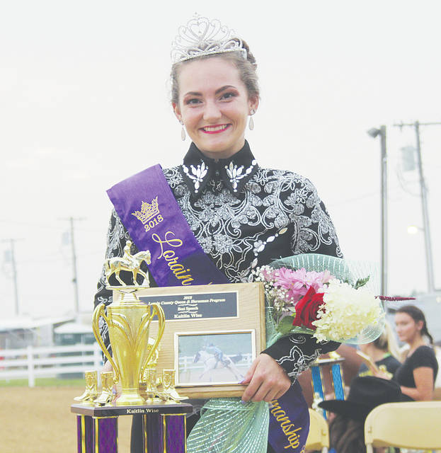 Kaitlin Wise celebrates after being crowned horsemanship queen at the Lorain County Fair.