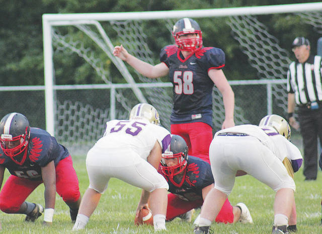 Phoenix defenders prepare for a snap in Friday's season opening loss to Vermilion.