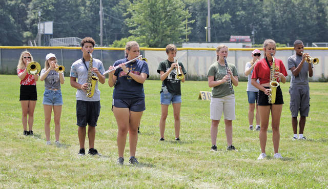 The August sun beats relentlessly as the Oberlin Marching Band takes the field for a recent practice. At 64, the roster is the largest in about two decades.