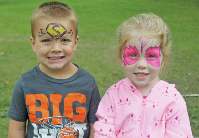 Annabelle Cole and Blake Lalonde grin after getting their faces painted at Saturday's Walk to End Alzheimer's in downtown Oberlin.