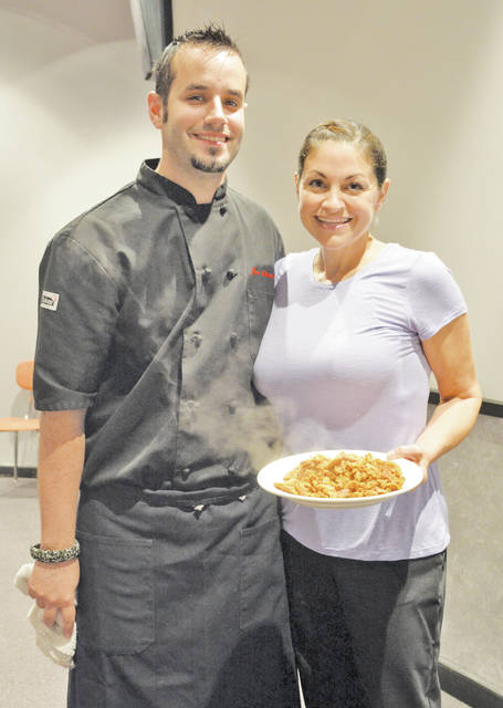Chef Jonathan Standen and Lori DePietro-Standen get ready to pass out the soy curls to students at the Lorain County JVS.