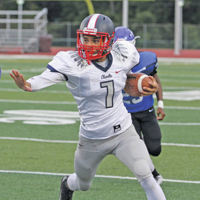 Quarterback Azarie Hairston runs for a first down on Oberlin's first drive.
