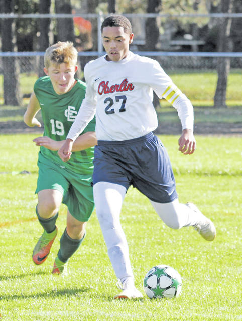 Cole Thompson makes a run in competition against Elyria Catholic, where the Phoenix surprised the second-seeded Panthers with a 2-1 win.