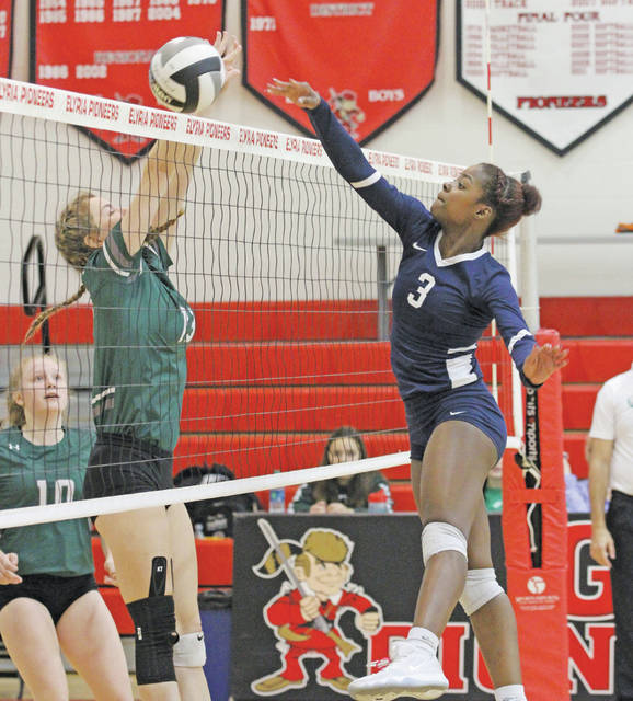 Nya Grady-Norman puts the ball over the net in the Phoenix's sectional finals victory.