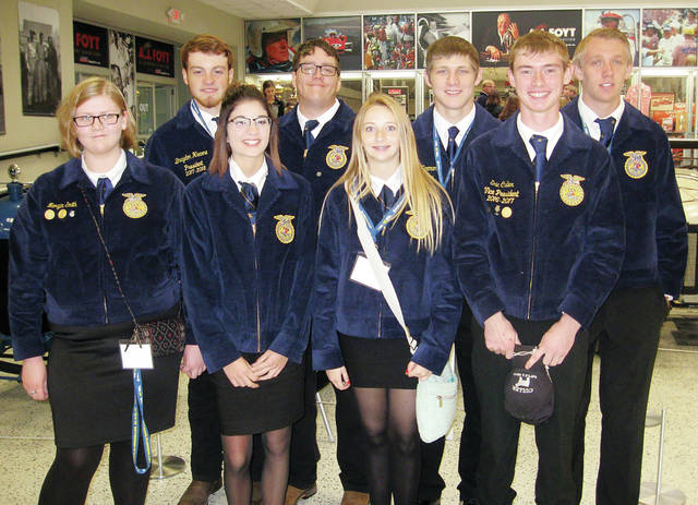 The Four County Career Center FFA Chapter had eight students attend the National FFA Convention in Indianapolis, Ind., last week. While they were at the convention students had the opportunity to attend the Rascal Flatts concert and the Professional Bull Riders Rodeo. Students and advisors also attended various student and teacher workshops as well as the Career Show and Expo. The students each had a Courtesy Corps assignment in the FFA shopping mall and assisted on the sales floor. Shown at the National FFA Convention are - front, from left - Morgan Smith of Edgerton, Kaylin Giesige of Hicksville, Abby Yeager of Defiance, Cole Crites of Fairview - back, from left - Braydon Hearne of Fairview, Matt Dietz of Hicksville, Timothy Herman of Edgerton, and George Kunkle of Hilltop. The girls are all in the Veterinarian Assistant program and the boys are in the Ag/Diesel Mechanics program.