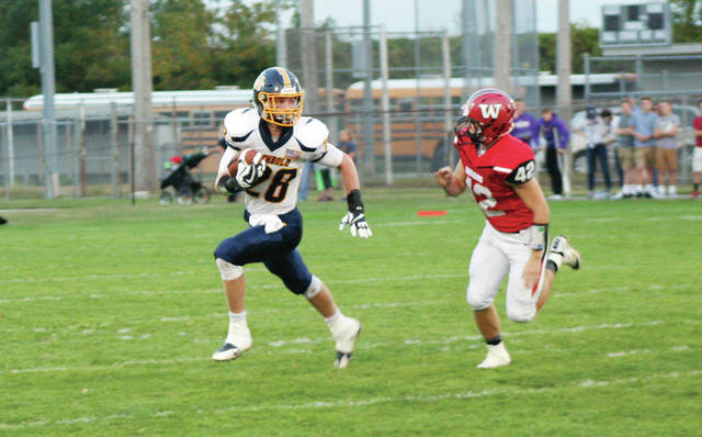 Sam Petersen of Archbold breaks free for a nice gain in a game at Wauseon this season. He will be leading the Blue Streaks at quarterback against Marion Pleasant this Friday, as twin brother Gabe Petersen is out for the rest of the season with a knee injury.