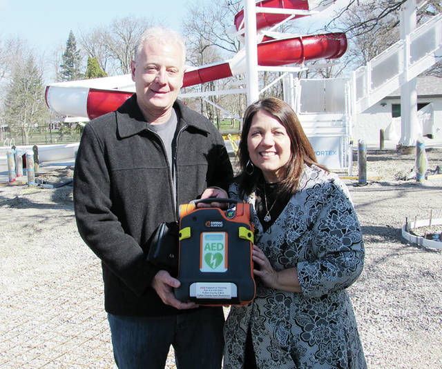 Ron Murd, a board member of the Fulton County Heart Radiothon, presented Wauseon Mayor Kathy Huner last week with an automated external defibrillator (AED), to be stationed at the city's new community pool currently under construction. Donations to the Heart Radiothon over the years have purchased a total of 140 AEDs, which have been donated for emergency use to locations around the county.