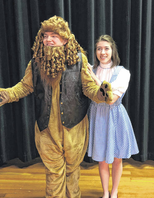 "Paige Moden, Dorothy, and Hunter Mattin rehearse for Wauseon's production of ""The Wiz."""