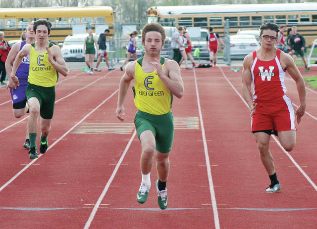 Hunter Vanwert of Evergreen, center, sprints to the finish in the 100 meter dash during a meet last season. He will look to return to state in the 100m this season.