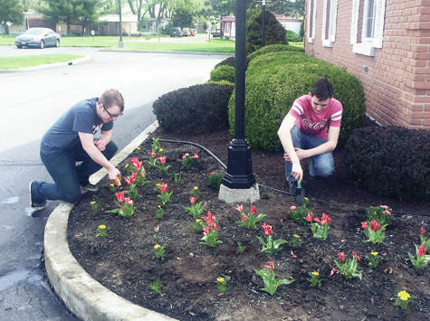 Two Wauseon FFA members performed landscaping duties during the chapter's recent Community Service Day. The FFA chapter partnered with the Wauseon Chamber of Commerce to fan out and assist city and Fulton County businesses for a day. Duties included anything to help provide service to the community.