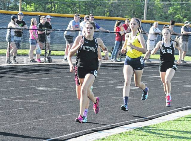 Elizabeth Sauder of Pettisville leads the pack in the 1600 meter run Friday at the Division III Tiffin Regional. She would advance to state in both the 1600m and 800m.