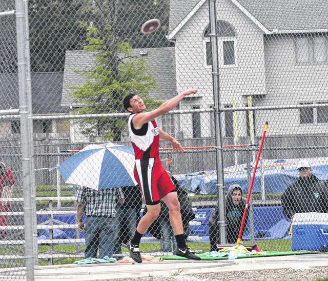 Kyle Zirkle of Wauseon throws in the boys discus Friday at the Division III Defiance district track meet. He won the discus with a throw of 150 feet, 6 inches.