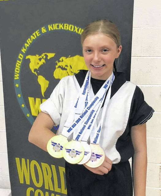 Katie Busse of Wauseon won two national titles and took second and third in two other events at the World Karate Commission National Tournament in Detroit June 8-9. The performance qualified her for Team USA where she will compete at the World Championships in Dublin, Ireland this fall.