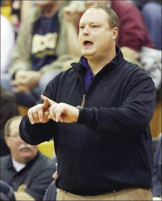 Derek Sheridan gives instruction from the bench during his time as head boys basketball coach at Maumee. Last week he was approved as the new coach at Delta.
