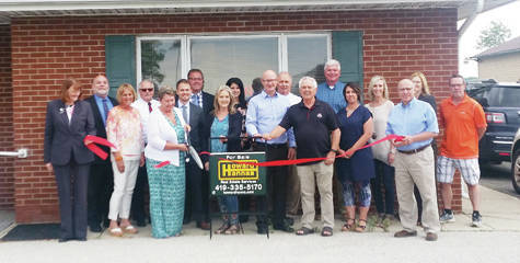 Phyllis Ritter, manager of Howard Hanna in Wauseon, cuts the ribbon during a grand opening ceremony held June 5. Located at 1384 N. Shoop Ave., and formerly Welles-Bowen, Howard Hanna offers real estate, mortgage, and title services, insurance, and property management. Hours are Monday-Thursday, 9 a.m. to 5 p.m., and Friday, 9 a.m. to noon. The business's seven agents are also available after hours. The phone number is 419-335-5170. Also pictured are Howard Hanna employees and members of the Wauseon Chamber of Commerce.