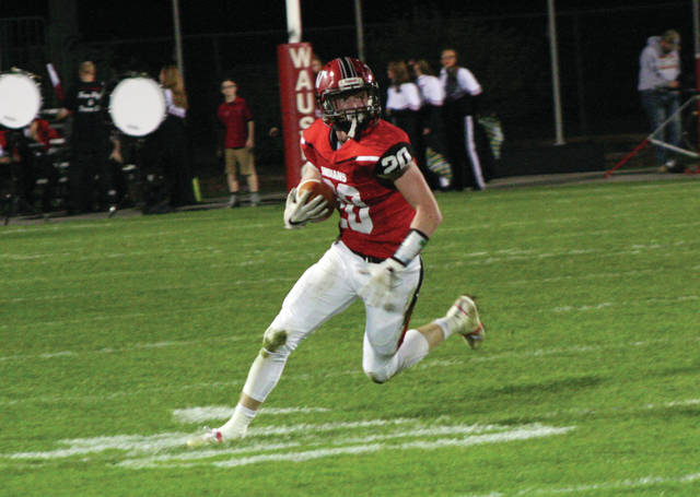 Wauseon's Everett Bueter picks up yardage on a reception during a regular season game this past season. He is one of many from the area taking part in the Northwest Ohio All-Star Football Game next Friday in Perrysburg.