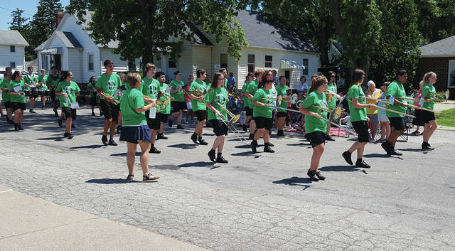The Delta High School band marches in last year's Chicken Festival parade.
