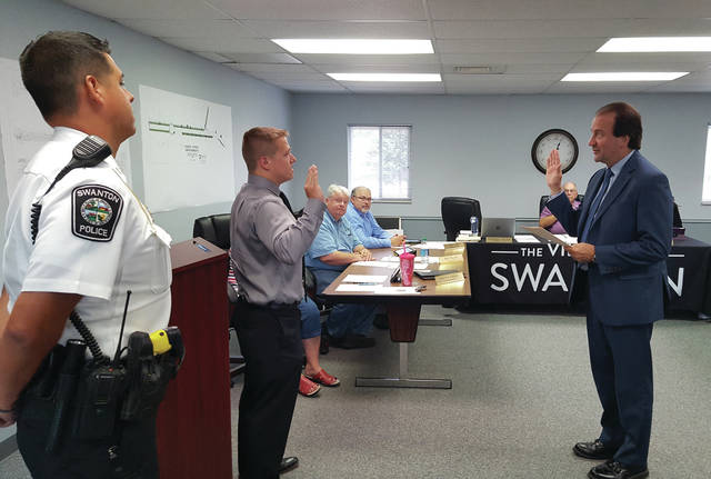 Joe Gill was sworn into the Swanton Police Department by Alan Lehenbaur during last week's Swanton Village Council meeting.