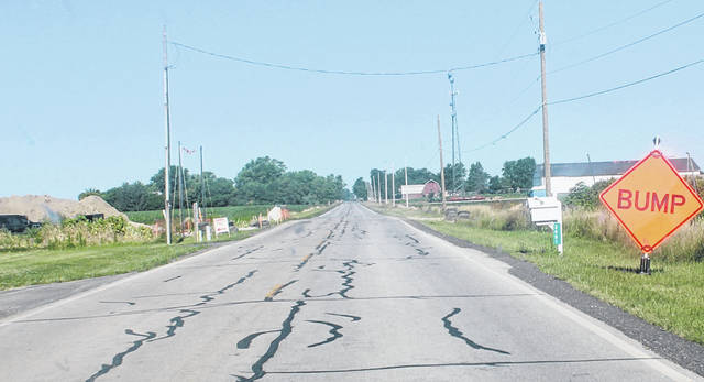"""A """"bump"""" sign was set up on County Road H between County Roads 3 and 4 at the intersection with the pipeline."""