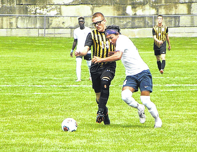 Joel Flory of Pettisville, left, attempting to keep Archbold's Josh Kidder from getting to the ball during Saturday's contest. The Bluestreaks defeated the Blackbirds by a 4-0 final.