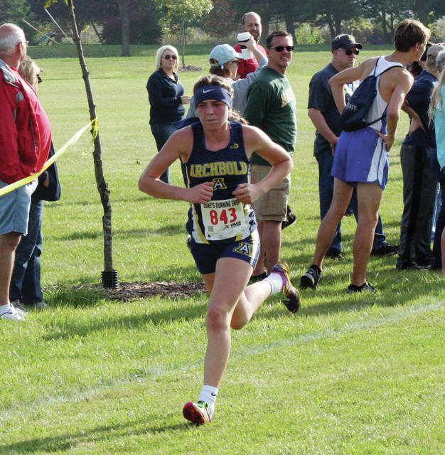 Kylie Sauder of Archbold runs at the NWOAL Championships last season. She was the best finisher for the Bluestreaks at the state meet a season ago, placing 32nd.
