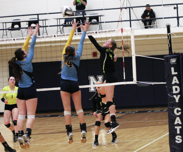 Pettisville's Morgan Leppelmeier with a kill from the left side during a match last season. She returns for her senior season in 2018.