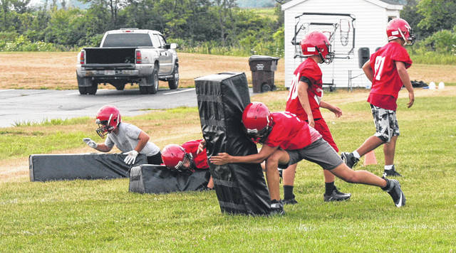 Wauseon defenders practice their tackling on dummies last week during the opening day of two-a-day practices. The Indians were picked to finish second in the league behind Liberty Center at the NWOAL coaches meeting Sunday.