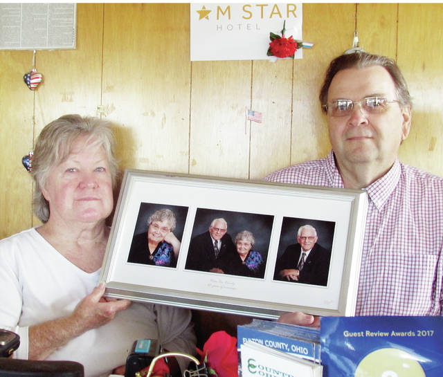 Robert and Mary Alice Gustwiller, displaying photos of his parents and M Star Hotel owners, Leo and Janet, have closed shop on the Wauseon business after selling the property to a developer.