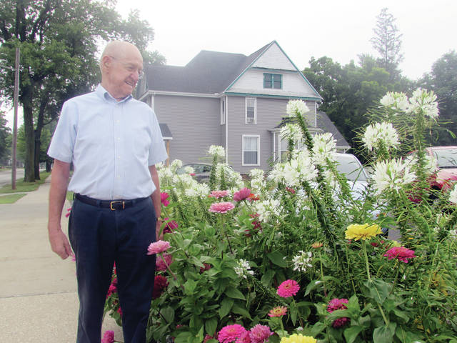 Bob Lehman admires the patch of flowers he grew at the FCHC Wellness Center in Wauseon.