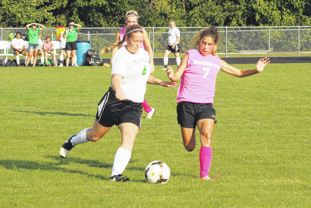 Marissa Cargill of Delta and Caroline Vargas of Swanton go for a ball during Tuesday's Northwest Ohio Athletic League contest. The Bulldogs shut out the Panthers, 4-0.