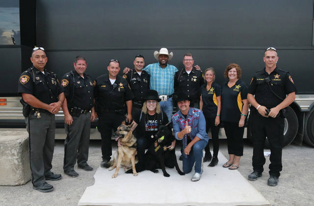 Big & Rich with members of the Fulton County Sheriff's Department.