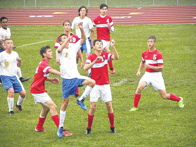 Westin Okuley of Continental (1) and Jameson Gray of Wauseon, right, get ready for a header during Monday's game. The Indians and Pirates finished in a 1-1 tie.