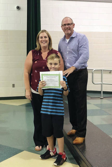 Delta Elementary Student of the Month Alex Keivens with Principal Ellen Bernal and Board member Dr. Michael Mattin.