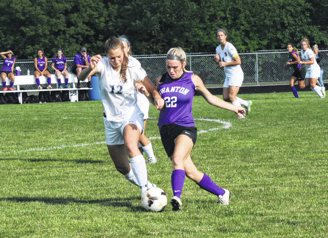 Lily Krieger of Archbold, left, and Bridget Harlett of Swanton battle for possession of the ball Thursday during a Northwest Ohio Athletic League contest. The Bluestreaks shut out the Bulldogs, 3-0.