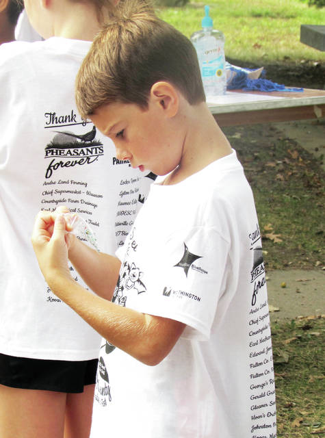 Kyle Snow of Wauseon Elementary School examines a sample during a discussion on water.
