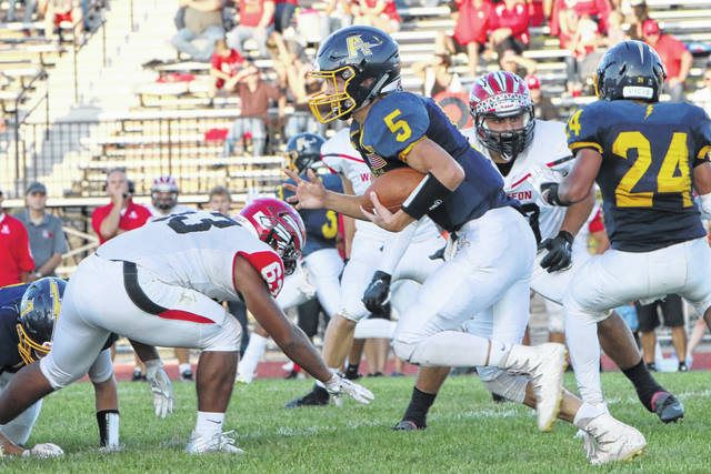 Archbold quarterback Brandon Taylor looks for room to run against Wauseon during a game Sept. 14. The Bluestreaks sit at seventh in the latest OHSAA computer rankings in Division V, Region 18.