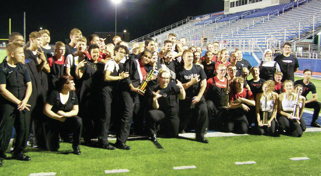 The Wauseon Marching Indians earned the Grand Champion honors at the Springfield Band Showcase - Springfield Ohio Music Education Association Marching Band Contest, held Sept. 15 at Springfield High School in Holland, Ohio. The 65-member Marching Indians also were awarded first place in Class B, Best Overall Music, and Best Overall Visual. They were under the direction of Don Clark, director; Jaz Bluhm, assistant director; Mark Cook, percussion; and Amber Wolpert, field commander. Soloists included Mackayla Kearney, guard; Katelyn Shadbolt, trumpet; Levi Waldron, mellophone; and Lucas Schang, baritone. The marching band continues its competition season Oct. 6 at the North Coast Marching Band Showcase at Sandusky and Oct. 20 at the Swanton Bulldog Bowl.