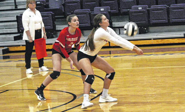 Kelcy Blanchong of Wauseon with a bump Thursday versus Defiance in a Division II district final at Bluffton University. The Indians won in four sets to win the district title.